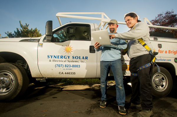 Synergy Co-owner Mike and team member Marvin review plans for solar installation