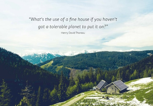"Roof-mounted solar panels on a remote house in the mountains with the quote by Henry David Thoreau: ""What's the use of a fine house if you haven't got a tolerable planet to put it on."""