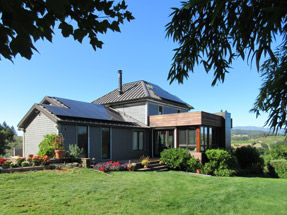 Roof-mounted solar panels on house