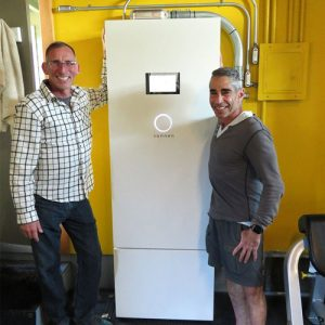 Satisfied Synergy Solar customers standing with their sonnenBatterie solar backup system