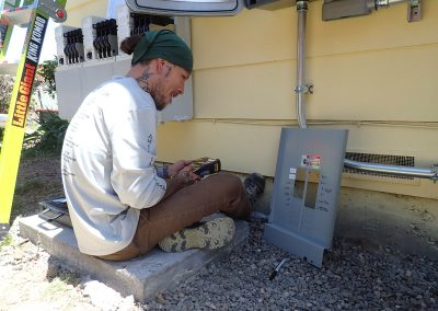 Synergy team member testing electrical connections